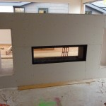 fireplace sheetrocked.  putting a venetian plaster type finish